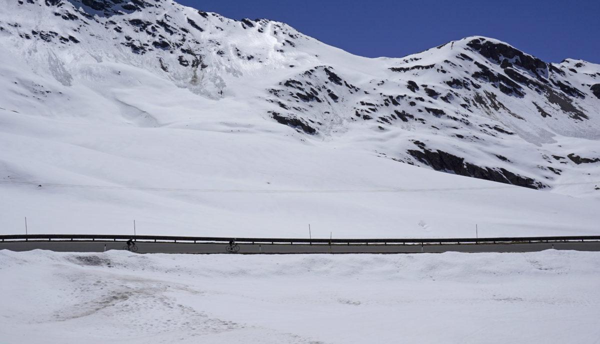 stelvio pass winter snow and cyclists